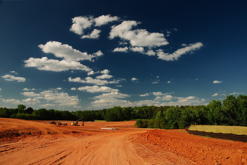 Clarke County (GA) May 2008<br /> <br /> Construction of the new athletic fields has begun just behind the Red Barn, on land now occupied by the University of Georgia's Animal and Dairy Science complex. One pasture has been removed, graded and an access road was built leading from the railroad crossing past the barn to the new fields.