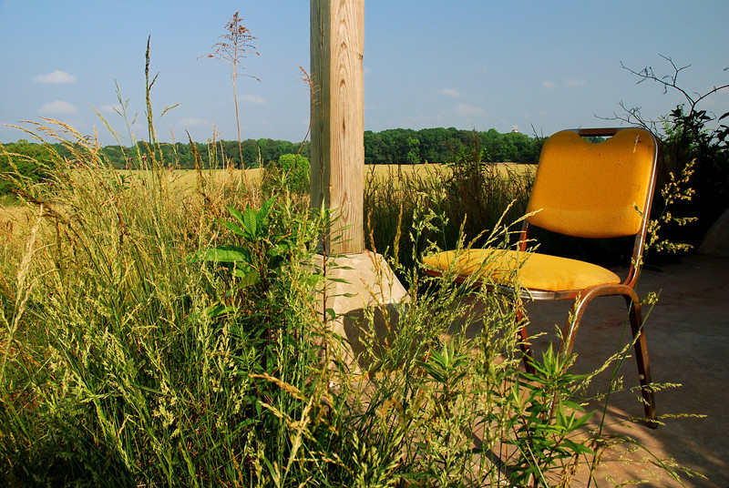 Chair overlooking the new construction behind the Red Barn. Clarke County (GA) May 2008