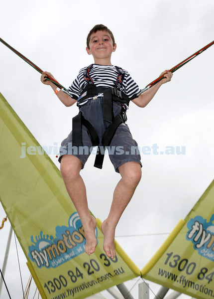 UIA Young Families event at The Entertainment Quarter. Andrew Biber on the Bungee trampoline. Pic Noel Kessel