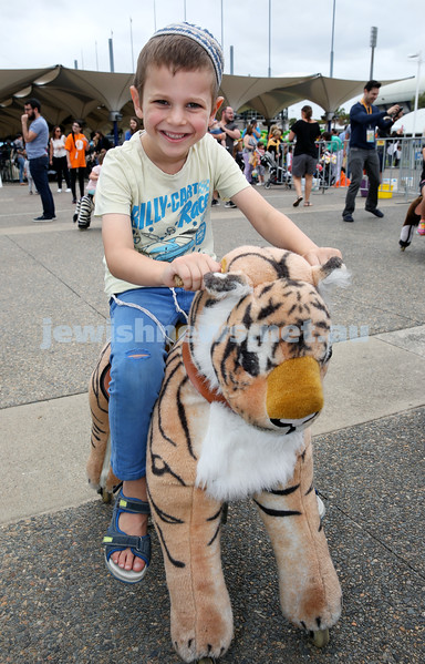 UIA Young Families event at The Entertainment Quarter. Moshe Schapiro rides a toy tiger. Pic Noel Kessel.