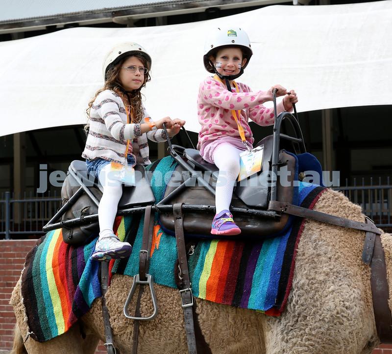 UIA Young Families fair at The Entertainment Quarter. Maya & Yali Neumann riding a camel.