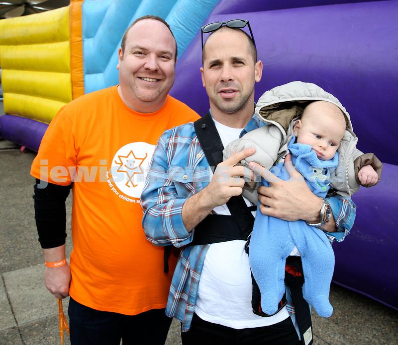 UIA Young Families fair at The Entertainment Quarter.  Yair Miller, Ricky Neumann with son Yair.