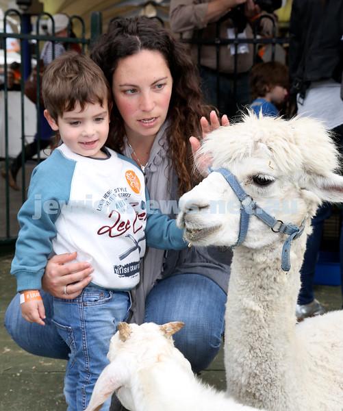 UIA Young Families fair at The Entertainment Quarter. Amanda & Ari Eisman in the petting zoo.