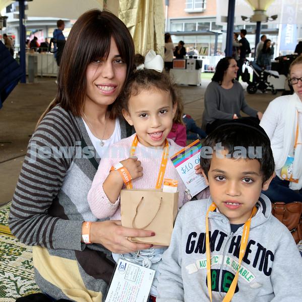 UIA Young Families fair at The Entertainment Quarter.  Shternie Dadon with children Chaya & Levi.