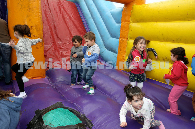 UIA Young Families fair at The Entertainment Quarter. Children on a jumping castle.