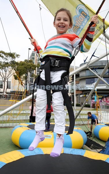 UIA Young Families fair at The Entertainment Quarter.  Tasha Roguff on the bungee trampoline.