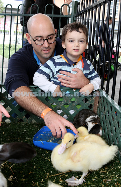 UIA Young Families fair at The Entertainment Quarter. Ronnie & Isaac Laifer in the petting zoo.