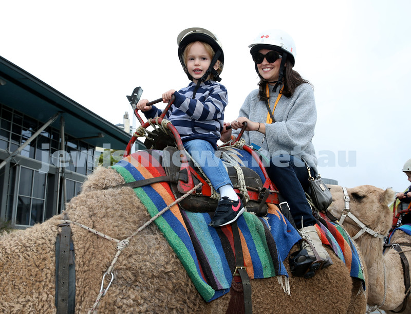 UIA Young Families fair at The Entertainment Quarter. Yanet Isdale and son Jed on a camel ride.