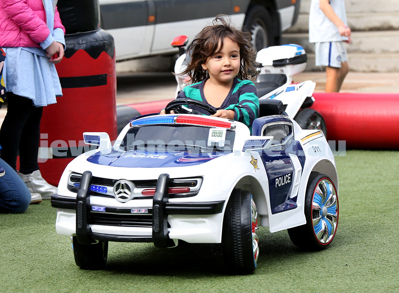 "UIA Young Families ""A Day In Jerusalem"" function. Zoe Levine rides a police car. Pic Noel Kessel"