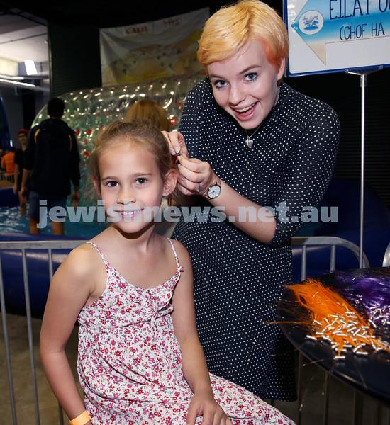UIA Young Families Israeli Summer Days at The Venue. Hannah Elliott braiding Lainey Sacks' hair. Pic Noel Kessel