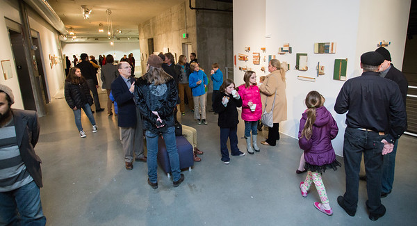 Guests looking at work of Tom Duimstra.