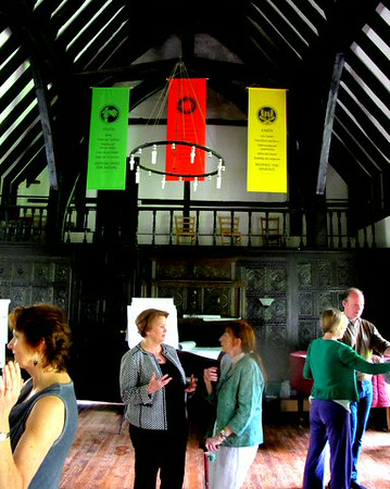 Gerrie and Pat Prepare Below The Five Element Banners