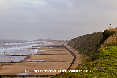 Mundesley Beach with Happisburgh Lighthouse in the distance