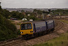 Local Pacer 143611 service leaves Dawlish Warren for Paignton.