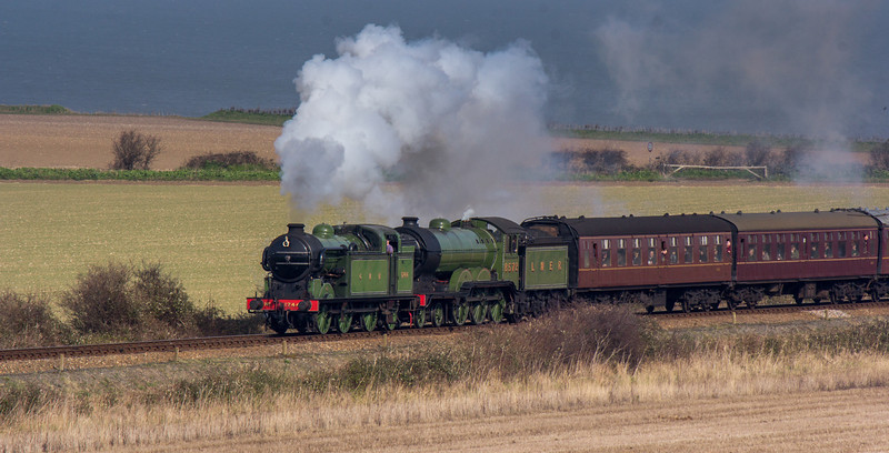 Double trouble, GNR Class N2 No.1744 and LNER B12 No.8572 approach Weybourne with a double-headed passenger service from Sheringham.
