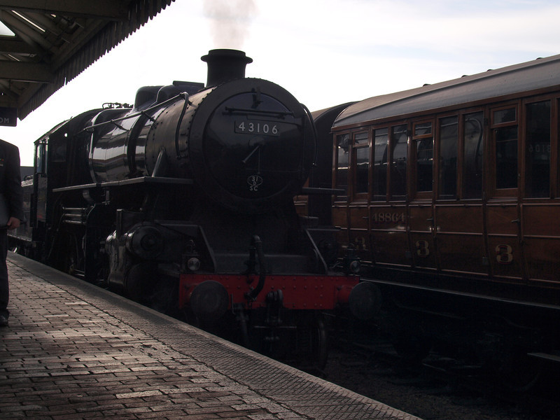 Ivatt design LMS 4MT No. 43106 at Sheringham Station. Gresley Quad-Articulated set in the background.