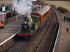 69023 and Gresley quad-articulated coaches arriving at Weybourne station.