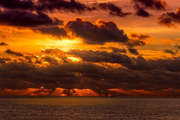 Sunset over the wind farm off Brighton
