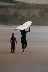 Surfers on Rhossili beach