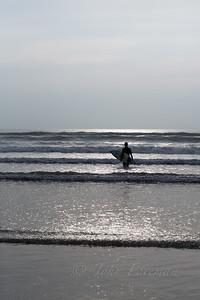 Surfer on Rhossili beach
