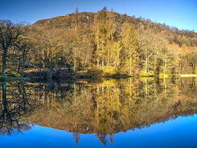 Reflections, Yew Tree tarn, Cumbria