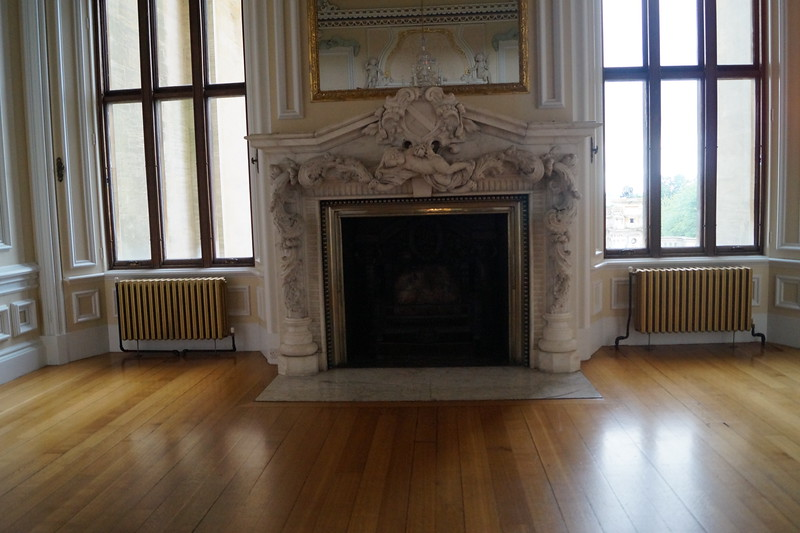 The ante-chamber between the state dining room and long gallery at Harlaxton. Notice the putti on the mantel. This was likely taken from a tomb.  The ceiling of this room is below.