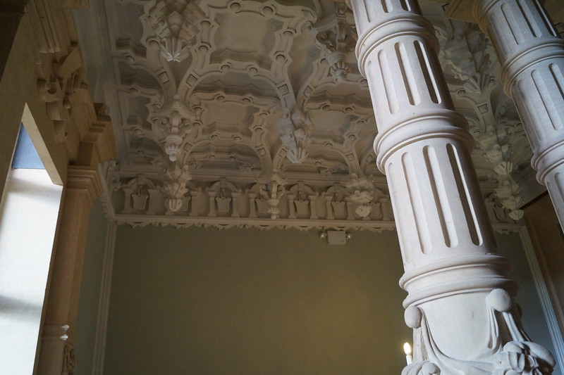The ceiling and pillars off the grand entry staircase near the door of the state dining room. Notice the corn, symbolizing agriculture on the photo of the pillar below.