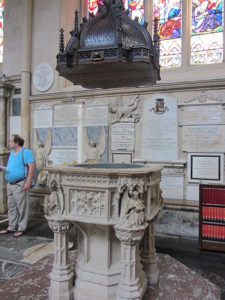 Baptismal font at Bath Abbey.