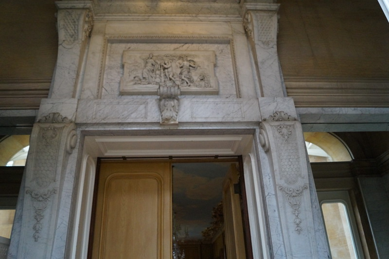 Decorative art on the doorway between the conservatory and the long gallery.
