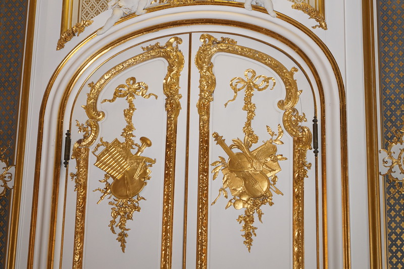 Doors int he Gold Room, or music room, at Harlaxton. A detail of the ceiling is below. Notice the puttis.