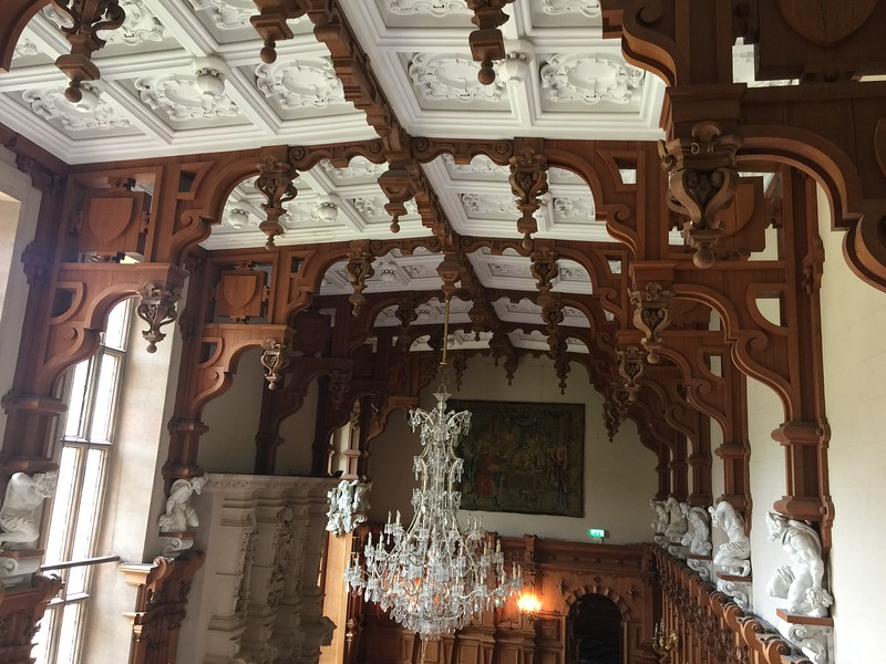 The amazing Jacobean ceiling and the crystal chandelier added by Violet van der Elst as seen from the minstrels' gallery.