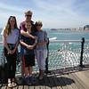 Having fun in the sun....Brighton pleasure pier looking the other way
