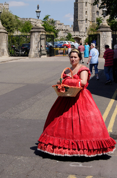 Girl street vendor in colourful red costume Windsor