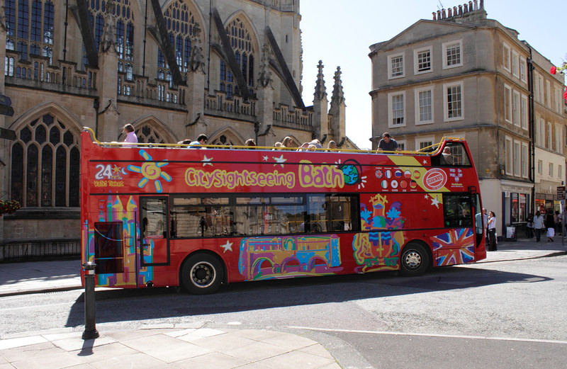 Tourist bus by Bath Abbey Somerset August 2011