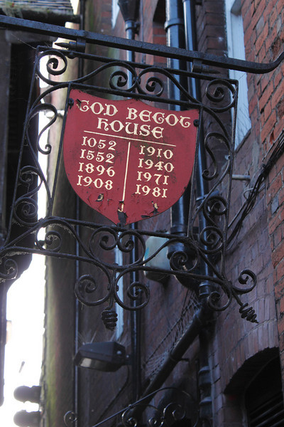 Sign for God Begot House off the High Street Winchester