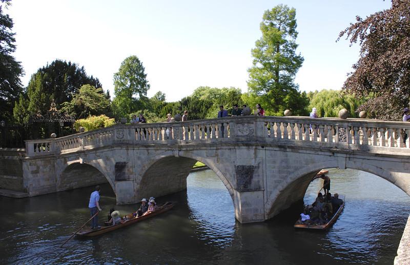 Punts passing under Clare Bridge on the River Cam Cambridge
