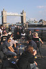People drinking by the Tower Millennium Pier and Tower Bridge London