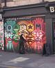 Graffiti and cyclist at Brick Lane London June 2013