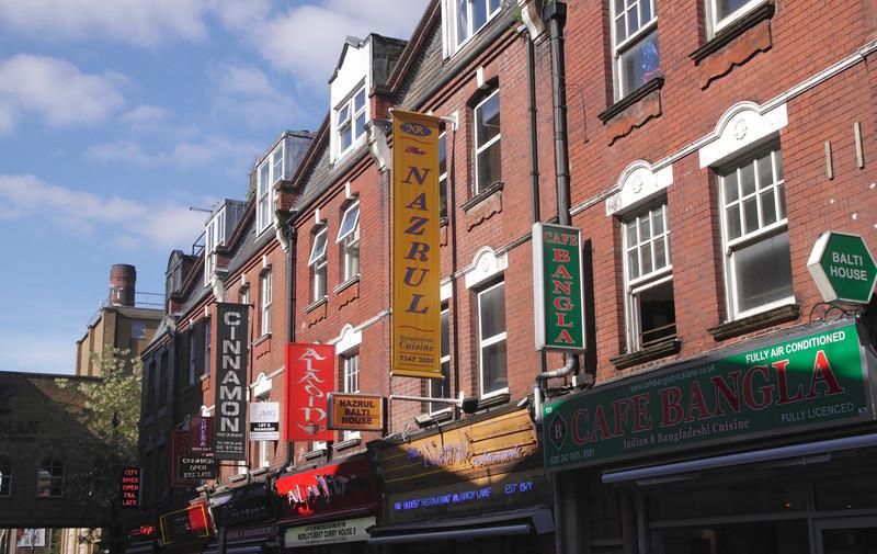 Indian Restaurant signs along Brick Lane London