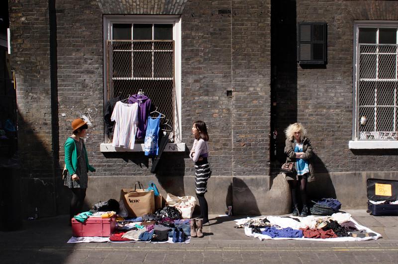 Traders selling their wares at Brick Lane Market London