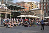 Street entertainer facing crowd of spectators at Covent Garden London summer 2010