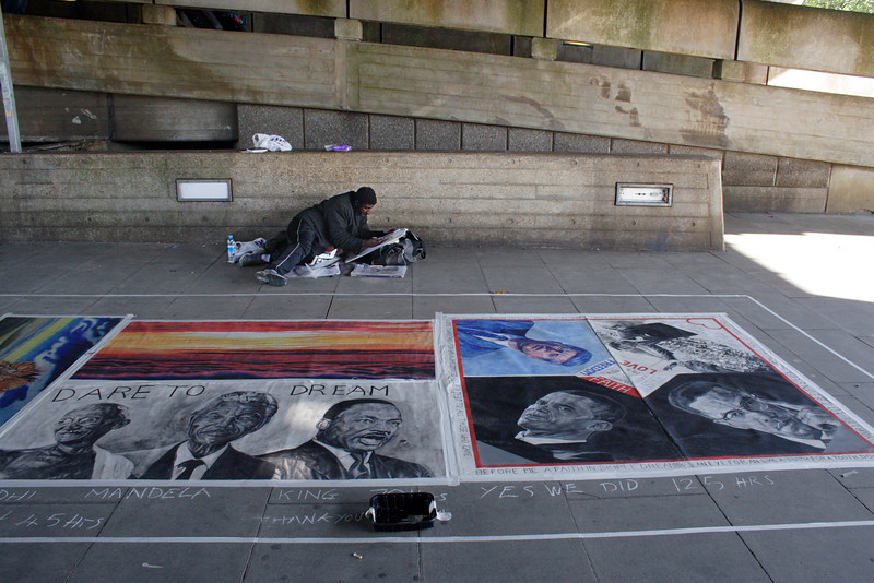Street Artist under the Hungerford Bridge South Bank London September 2009