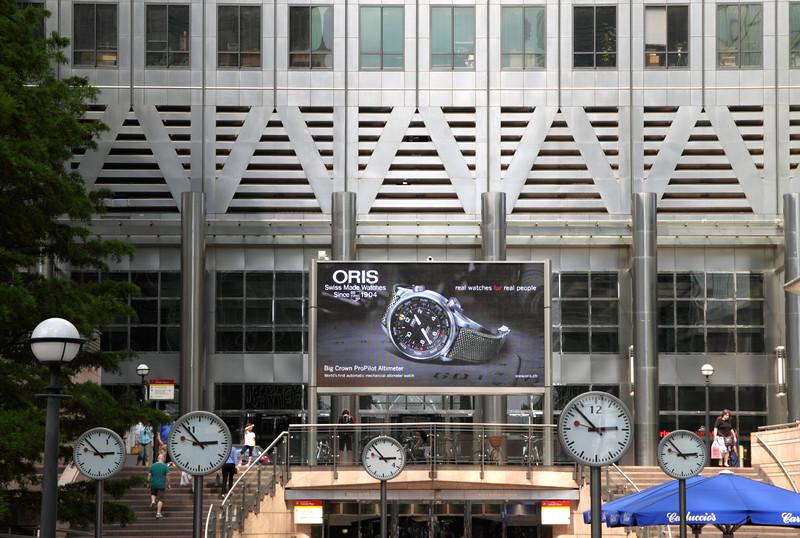Clocks at Reuters Plaza at Canary Wharf London England