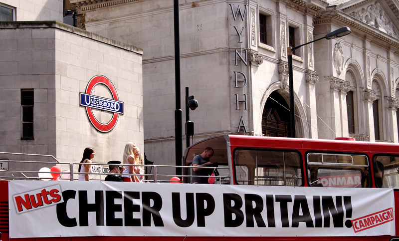 Double decker London bus at Charing Cross Road displaying Cheer Up Britain banner April 2009