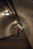 Pedestrians walking through Greenwich Foot Tunnel London