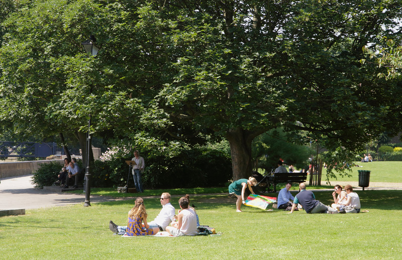 People relaxing at Furnival Gardens Hammersmith London