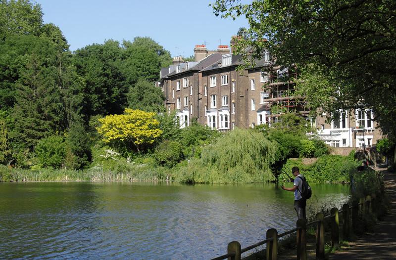 Man fishing Highgate ponds Hampstead Heath London