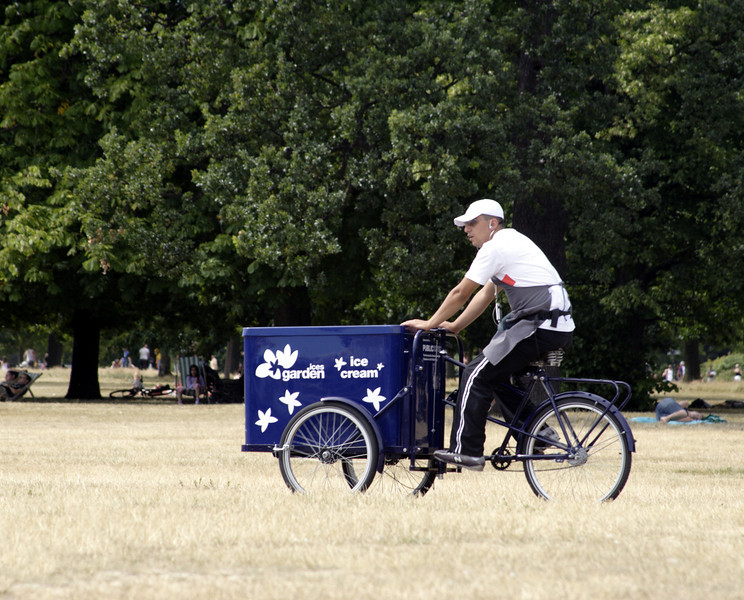 Ice cream salesman on tricycle Kensington Gardens London