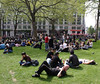 People relaxing at Leicester Square Gardens London April 2009