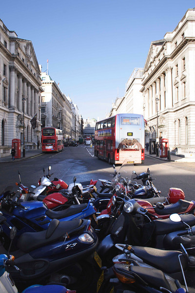 Parked motorbikes and London Buses at Regent Street London January 2007